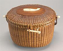 RARE NANTUCKET BASKET PURSE By José Formoso Reyes. Deep rich patina. Whale ivory whale-form plaque mounted to top, and whale ivory k...