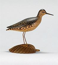 RARE MINIATURE YELLOWLEGS By A. Elmer Crowell of East Harwich, Massachusetts. Mounted on a scallop shell-form base. Inscribed on und...