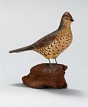 MINIATURE RUFFED GROUSE By A. Elmer Crowell of East Harwich, Massachusetts. Mounted on a driftwood base. Unsigned.