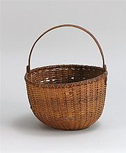 NANTUCKET BASKET WITH SWING HANDLE Splint work sides and turned wooden base. Wonderful patina. Overall height 10½