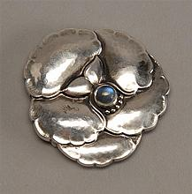 GEORG JENSEN SILVER BROOCH in the form of a pansy set with a central moonstone. Length 1.5