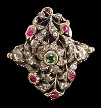 19TH CENTURY RUBY, DIAMOND, AND EMERALD RING in a filigree design highlighted with six rubies, one emerald, and approximately twenty...