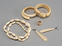 SIX PIECES OF IVORY JEWELRY: two bracelets, necklace, ring, and pair of earrings. One bracelet with figural carving and one in a mod...