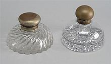 TWO GLASS INKWELLS with metal tops. Heights 4