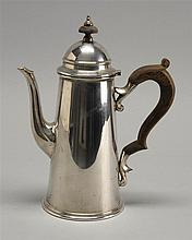 STERLING SILVER COFFEE POT BY REDLICH & CO. in lighthouse-form with ebony handles and finial. Height 9