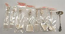 SET OF EIGHT REED & BARTON STERLING SILVER SERVING PIECES. All with elaborate floral handles.Approx. 6.6 troy oz.