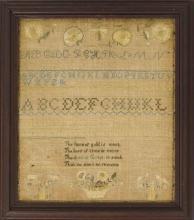 FRAMED NEEDLEWORK SAMPLER Upper half with alphabet and numerals. Lower half with verse