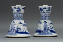 PAIR OF CHINESE EXPORT CANTON PORCELAIN CANDLESTICKS With bell form bases. In traditional blue and white designs. Heights 5.75