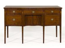 ANTIQUE AMERICAN HEPPLEWHITE SIDEBOARD In mahogany with select mahogany veneer. Three drawers across top. Central serpentine-shaped...