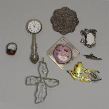 EIGHT STERLING SILVER ITEMS Five brooches, one ring, a miniature picture frame, and a large cross-form pendant with sterling silver...