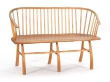 WINDSOR-STYLE BENCH In walnut and oak with spindle back and stretcher base. Seat height 16.5