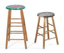 TWO PAINTED WOODEN STOOLS One with image of a pig, signed