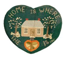 HOOKED WELCOME MAT In the form of a heart. Depicts a cottage between two trees on a green ground.