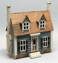 MINIATURE WOODEN MODEL OF A HOUSE A gray clapboard Cape Cod-style house with two dormers and a chimney on each side. Intentionally w...