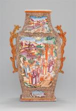 CHINESE EXPORT ROSE MANDARIN PORCELAIN VASE In modified rectangular form with rust red and gilt dragon-form handles. Body decorated...
