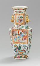 CHINESE EXPORT PORCELAIN HEXAGONAL VASE With flared rim and gilt foo dogs at neck. Decorated with Mandarin scenic panels surrounded...