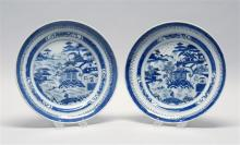 PAIR OF CHINESE EXPORT CANTON PORCELAIN SHALLOW BOWLS Both with deep cobalt blue scenic decoration. Diameters 9.88