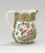 CHINESE EXPORT PORCELAIN OCTAGONAL PITCHER With strap handle. Mandarin and Famille Rose paneled decoration with unusual wide green b...