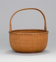 NANTUCKET LIGHTSHIP BASKET By William Appleton (Nantucket, 1851-1918). In circular form with swing handle. Partial paper label on un...