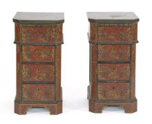 PAIR OF CHINOISERIE-DECORATED END CABINETS With red painted decoration. Each cabinet with four drawers, chamfered corners, bracket f...