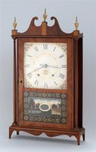 SETH THOMAS PILLAR AND SCROLL SHELF CLOCK In mahogany veneers with three brass finials. Painted wooden dial. Lower reverse-painted g...
