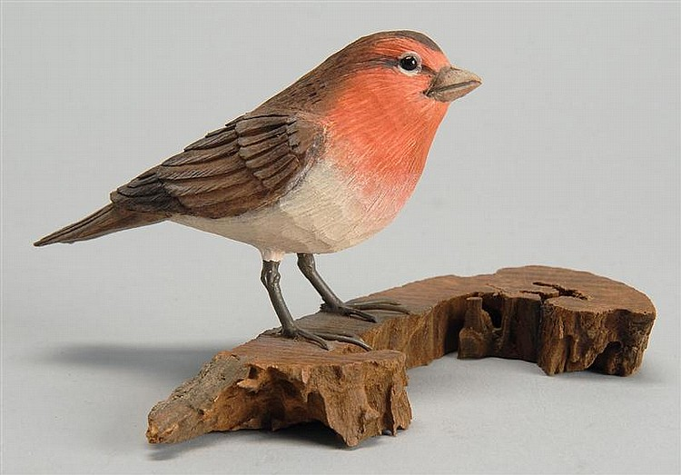 """LIFE-SIZE PURPLE FINCH by Stan Sparre of Cape Cod, Massachusetts. Signed """"Stan Sparre, Cape Cod"""". Mounted on a driftwood base."""