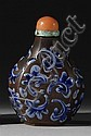 YI HSING POTTERY SNUFF BOTTLE In hexagonal pear shape with blue foliate scrolling on a brown ground. Height 2