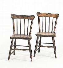 PAIR OF PLANK-SEAT SIDE CHAIRS Under brown-black paint with red and yellow highlights. Shaped crests.