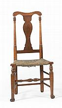 ANTIQUE AMERICAN QUEEN ANNE SIDE CHAIR In maple with vasiform splat back, turned front stretcher and padded front feet. Rush seat.