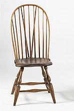 ANTIQUE AMERICAN BOWBACK WINDSOR SIDE CHAIR In maple and oak. Shaped seat on turned splayed legs.