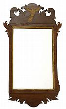 ANTIQUE AMERICAN CHIPPENDALE MIRROR In mahogany veneer. Scrolled crest with central gilt eagle decoration. 31