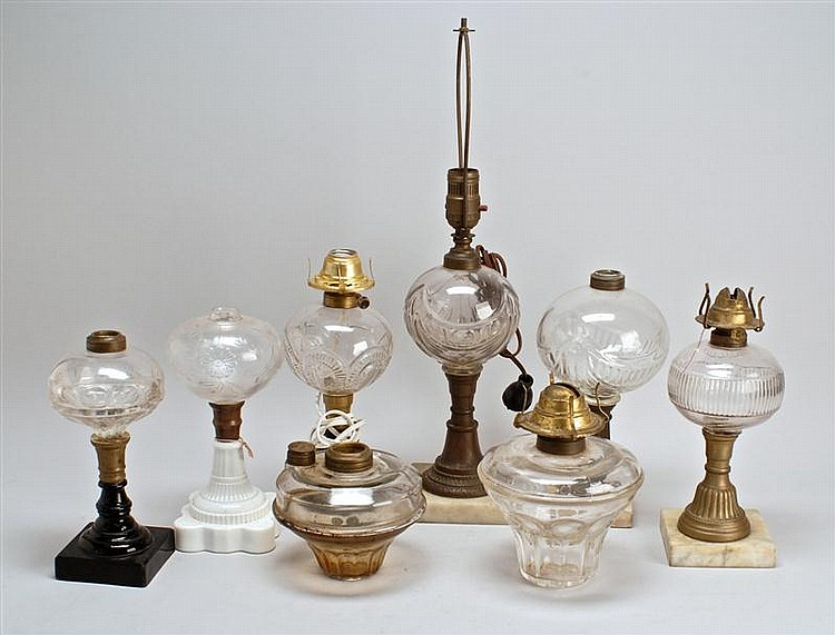 SIX ASSORTED ANTIQUE AMERICAN TABLE LAMPS Together with two oil lamps, which never had bases. Lamps with clear fonts and various bas...