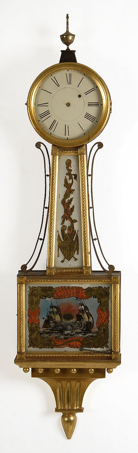 ANTIQUE AMERICAN BANJO CLOCK Maker unknown. Gilt wooden bezel, and gilt throat, door and presentation bracket. Reverse painting of a...