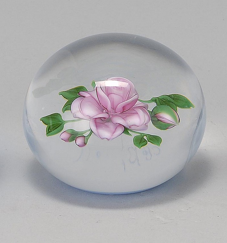 "GLASS PAPERWEIGHT BY VICTOR TRABUCCO Depicting a pink rose with leaves and several buds. Signed ""Trabucco"" and dated 1985 on lower s..."