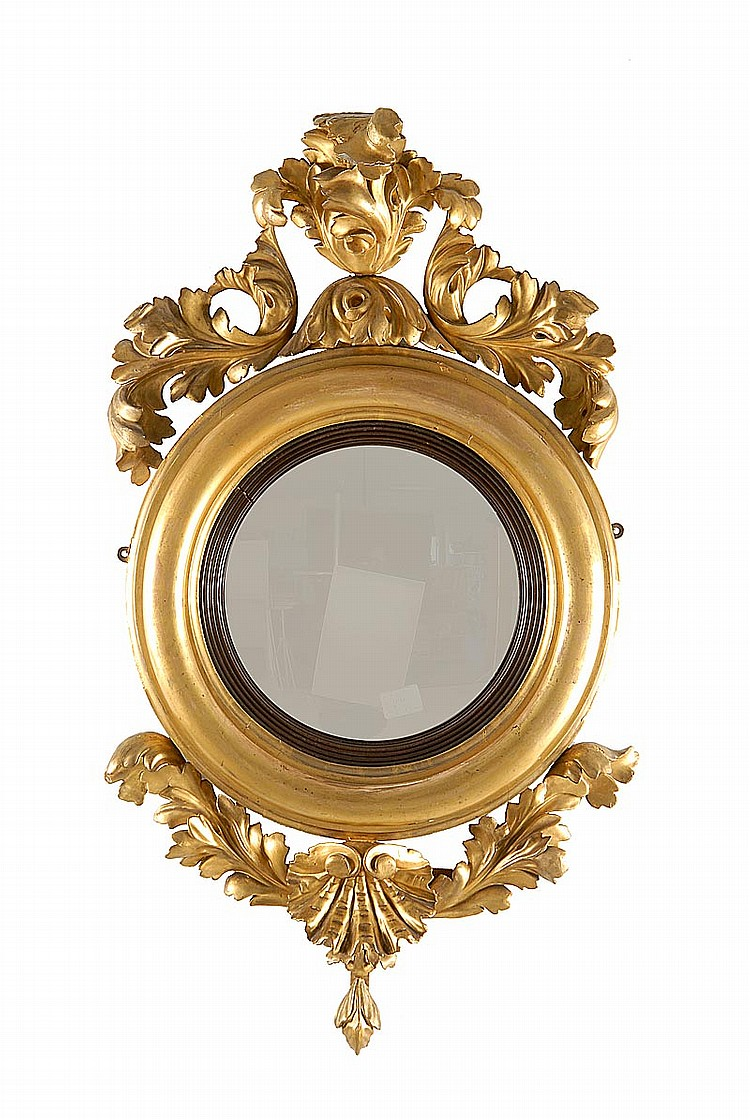 ANTIQUE CONVEX MIRROR Gilt frame with attached upper and lower foliate mounts. Height approx. 36½