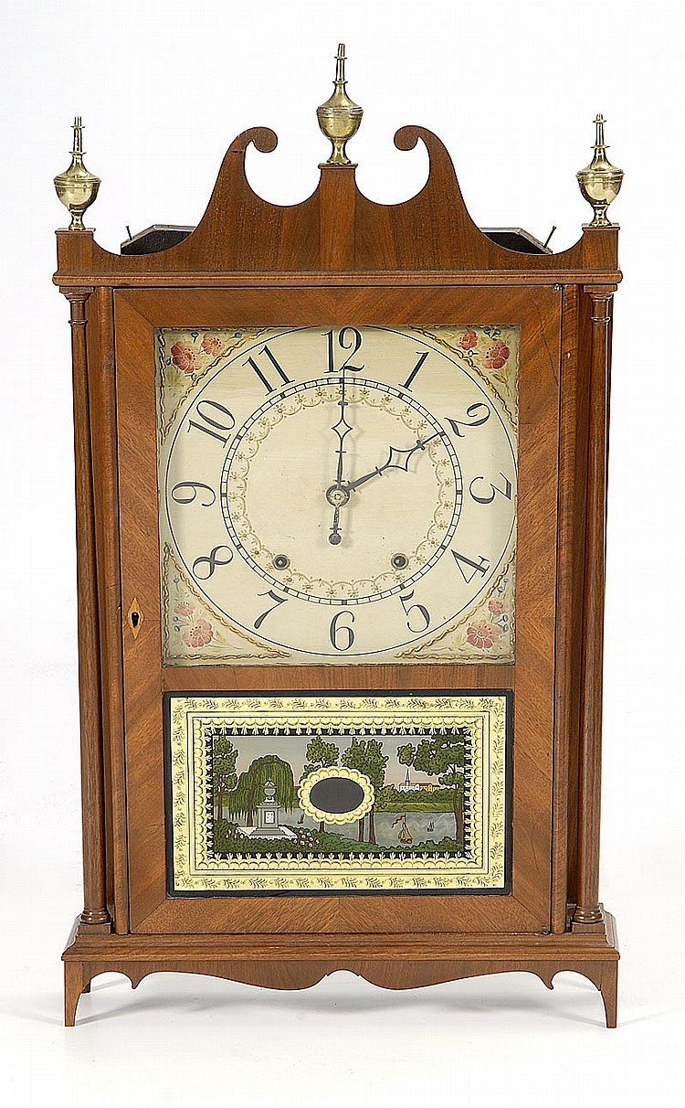 ANTIQUE AMERICAN ELI TERRY PILLAR & SCROLL CLOCK In mahogany and mahogany veneers. Broken arch pediment with brass urn-form finials....