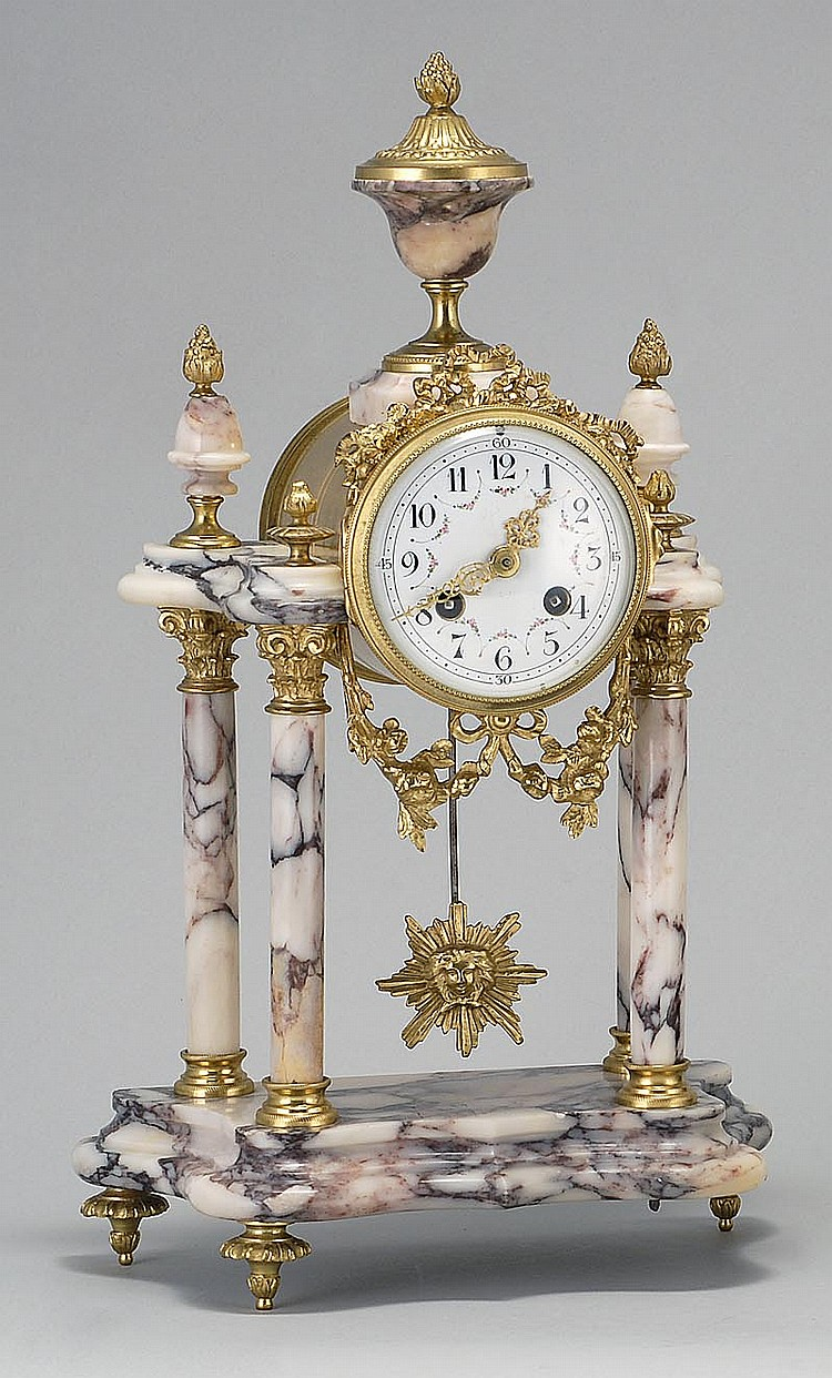 FRENCH ALABASTER AND ORMOLU REGULATOR CLOCK With urn finial, and floral and scroll embellishments. Enamel dial. Height 15