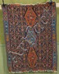ORIENTAL RUG: KILIM Three linked geometric medallions of rust-red and light blue contain small stylized elements. Dark blue field wi...