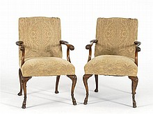 PAIR OF GEORGIAN-STYLE ARMCHAIRS In walnut with nicely carved scrolled arms and carved cabriole legs with shell-carved knees. Beige...