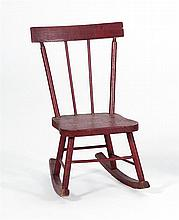 CHILD'S SIZE WINDSOR ROCKER In red paint with stenciled gold lettering on seat