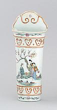 POLYCHROME PORCELAIN WALL POCKET In quiver form with figural landscape design. Length 10.5