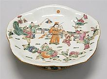 FOOTED SERVING DISH In five-lobed form with famille rose figural design. Six-character mark on base. Diameter 9.25
