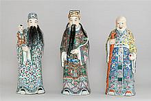 SET OF THREE POLYCHROME PORCELAIN FIGURES Depicting the