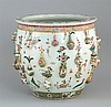 FAMILLE ROSE PORCELAIN JARDINIÈRE In ovoid form with unusual relief vase design. Diameter 15.5