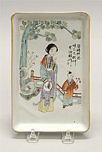 POLYCHROME PORCELAIN DISH In rectangular form depicting a woman and child in a garden. Length 7.5