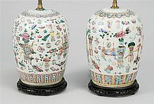 PAIR OF PORCELAIN COVERED JARS In melon form. Converted to table lamps. Height of jars 13