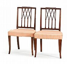 PAIR OF ANTIQUE AMERICAN HEPPLEWHITE FANCY SIDE CHAIRS In mahogany. Intricately carved and molded Gothic-influenced backs. Over-upho...
