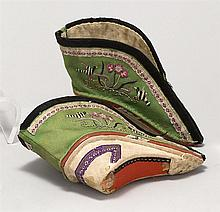 PAIR OF LOTUS SHOES In green cotton embroidered with black & white striped birds on one side and multicolored birds on the other. Re...