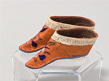 PAIR OF RED SILK LOTUS SHOES With pink, green, and blue floral embroidery. Brown cotton insides. Blue and white cotton sole. Length...