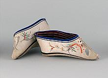PAIR OF PALE GREEN LOTUS SHOES With fine silk-embroidered design of a bird on a flowering tree branch. Length 6